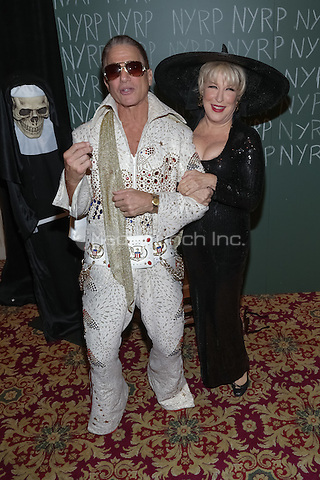 """NEW YORK, NY - OCTOBER 31 : Actor Tony Danza (L) and Singer and Actress Bette Midler arrive for the New York Restoration Project's 19th Annual Hulaween Gala """"FELLINI HULAWEENI"""" held at the Waldorf Astoria on October 31, 2014 in New York City.  (Photo by Brent N. Clarke / MediaPunch)"""