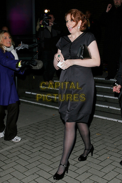 CATHERINE TATE .At the aftershow party for the National Television Awards, Movida nightclub, London, England..October 29th, 2008.NTA after show full length black dress mary janes shoes clutch bag .CAP/AH.©Adam Houghton/Capital Pictures.