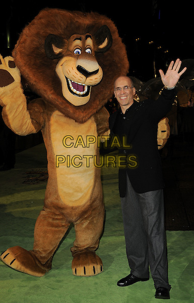 "JEFFREY KATZENBERG.The ""Madagascar Escape 2 Africa"" - UK Premiere - Outside Arrivals at Empire Leicester Square, London, England. November 23rd 2008.full length glasses black jacket jeans denim hand palm waving lion dress-up costume.CAP/CAN.©Can Nguyen/Capital Pictures."
