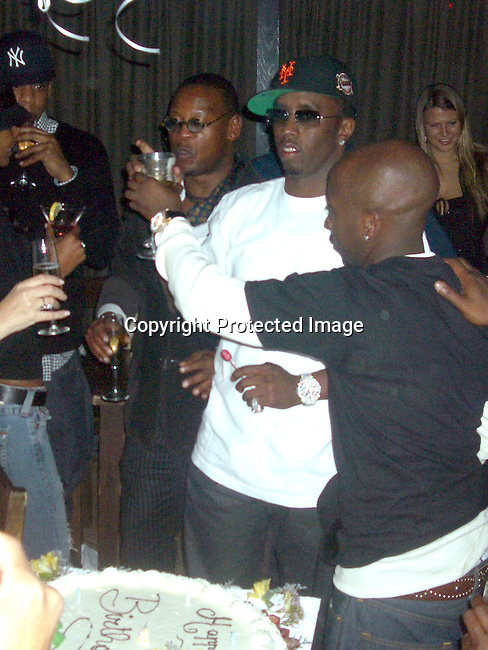 Jay-Z, Andre Harrell, Kim Porter and Sean P. Diddy Combs<br />