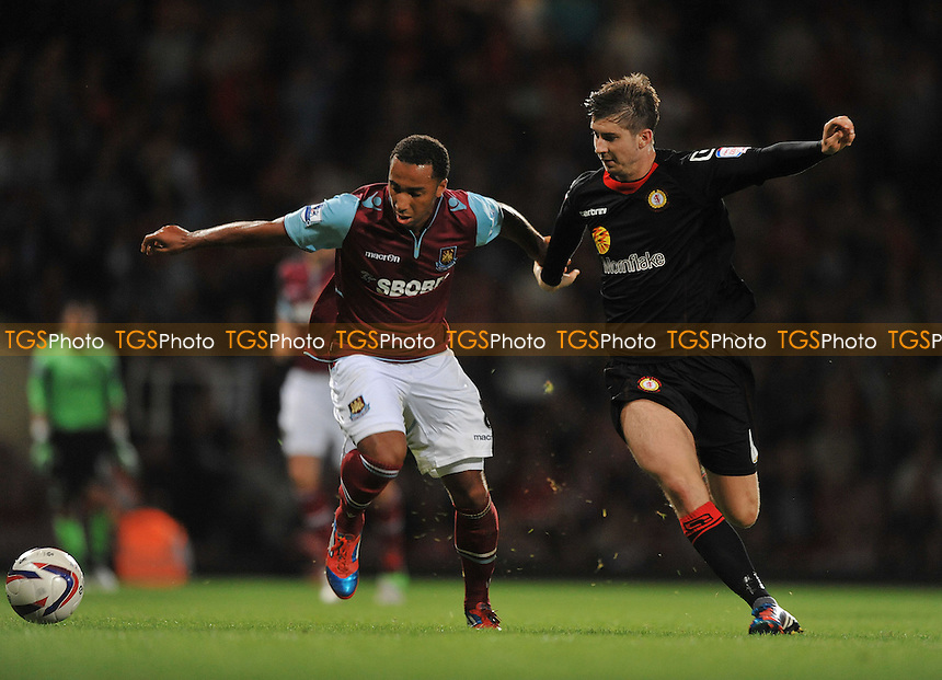 Nicky Maynard of West Ham Utd and Luke Murphy of Crewe Alexandra - West Ham United vs Crewe Alexandra -Capital One Cup Second Round Football at Upton Park, London - 28/08/2012 - MANDATORY CREDIT: Martin Dalton/TGSPHOTO - Self billing applies where appropriate - 0845 094 6026 - contact@tgsphoto.co.uk - NO UNPAID USE.