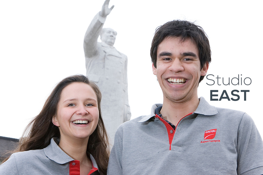 EMLyon Business School students Marie Allilaire, left, and Patrick Baraut, right, pose on the Asian campus of the school, by a statue of Mao Zedong, in Shanghai, China, on April 7, 2010. Photo by Lucas Schifres/Pictobank