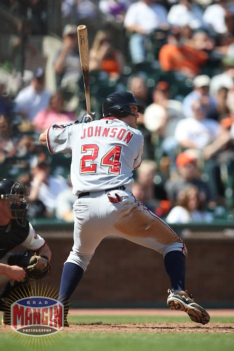 SAN FRANCISCO - MAY 13:  Nick Johnson #24 of the Washington Nationals bats against the San Francisco Giants during the game at AT&T Park on May 13, 2009 in San Francisco, California. Photo by Brad Mangin