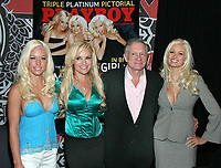 "27 September 2017 - Hugh Marston Hefner aka ""Hef"" was an American magazine publisher, editor, businessman, and international playboy best known as the editor-in-chief and publisher of Playboy magazine, which he founded in 1953. Hefner was the founder and chief creative officer of Playboy Enterprises, the publishing group that operates the magazine. Hefner was also a political activist and philanthropist. File Photo: 11 October 2005 - Virgin Megastore Times Square, NYC - Kendra Wilson, Bridget Marquardt,  Holly Madison, Hugh Hefner sign copies of Nov. 2005 issue of Playboy Magazine. Photo Credit Jackson Lee/AdMedia"