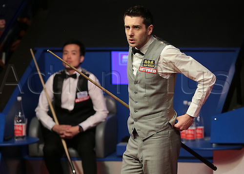 30.04.2016. The Crucible, Sheffield, England. World Snooker Championship. Semi Final, Mark Selby versus Marco Fu. Mark Selby takes a look at the frame time on the scoreboard, which turns out to be a new world record at 76 minutes 11 seconds