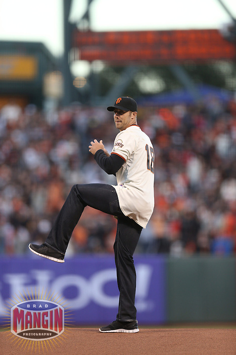 SAN FRANCISCO - OCTOBER 6:  Quarterback Alex Smith of the San Francisco 49ers throws out the first pitch before Game 1 of the NLDS between the Cincinnati Reds and San Francisco Giants at AT&T Park on October 6, 2012 in San Francisco, California. (Photo by Brad Mangin)