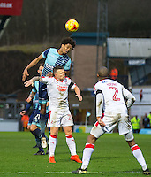 Sido Jombati of Wycombe Wanderers beats Dean Cox of Crawley Town to the ball during the Sky Bet League 2 match between Wycombe Wanderers and Crawley Town at Adams Park, High Wycombe, England on 25 February 2017. Photo by Andy Rowland / PRiME Media Images.