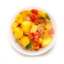 Raw vegetables for stir-fry including pineapple, red and green peppers, and onion