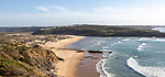 Panorama view of river mouth of Ribeira de Aljezur reaching the Atlantic Ocean and whitewashed buildings of Clero village, Aljezur, Algarve, Portugal, Southern Europe