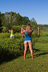 Young women shooting rifles