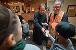 A gift in the tradition of St. Nicholas is given to the the children after Christmas Eve Vigil Service, St. Sava Serbian Orthodox Church, Jackson, Calif..