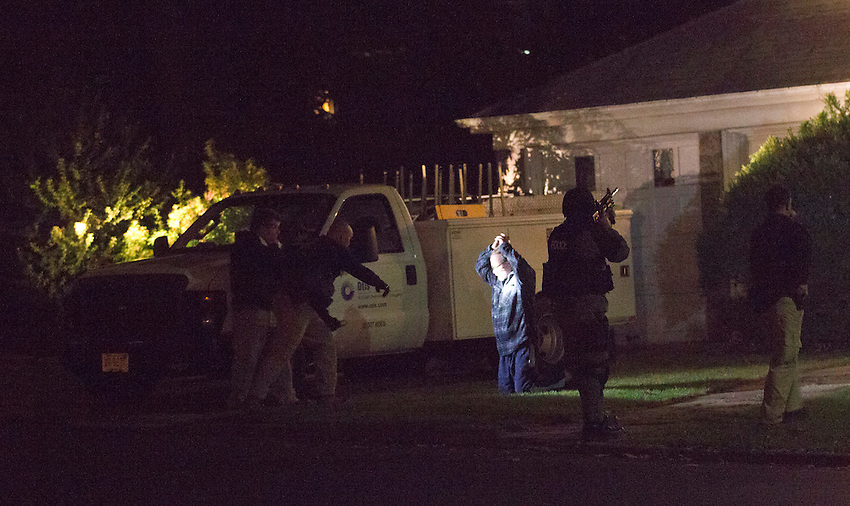 """TEANECK, NJ (Nov. 4, 2013) —New Jersey State Police scream """"Dorp it, drop it!"""" as they take the father of Richard Shoop into custody at gunpoint at about 1 am after the elder Shoop emerged from his Teaneck home brandishing a screwdriver hours after his 20-year-old son opened fire at the nearby Garden State Plaza in Paramus."""