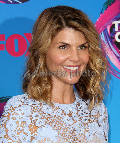 13 August 2017 - Los Angeles, California - Lori Loughlin. Teen Choice Awards 2017 Arrivals held at The Galen Center in Los Angeles. Photo Credit: AdMedia