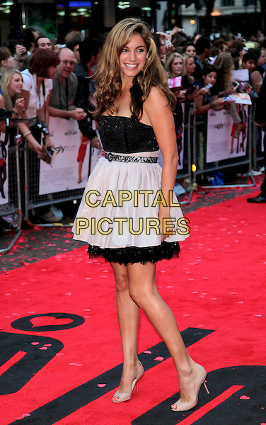 "KELLY BROOK .At the UK Film Premiere of ""The Ugly Truth"" at  held at the Vue West End, Leicester Square, London, England, UK, August 4th 2009..full length strapless black dress belt cream white petticoat fifties prom style hand on hip peep toe beige shoes grey gray lace .CAP/CAS.©Bob Cass/Capital Pictures"