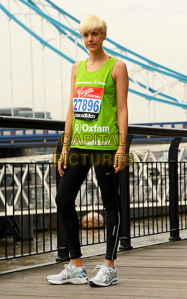 AGYNESS DEYN.Virgin London Marathon photocall, London, England..April 15th, 2011.exercise full length green neon sleeveless vest top black spandex trainers sneakers  .CAP/CJ.©Chris Joseph/Capital Pictures.