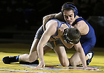 SIOUX FALLS, SD: DECEMBER 8: TJ North from Augustana controls Isaac Andrade from South Dakota State in their 125 pound match Sunday afternoon at the Sanford Pentagon. (photo by Dave Eggen/Inertia)