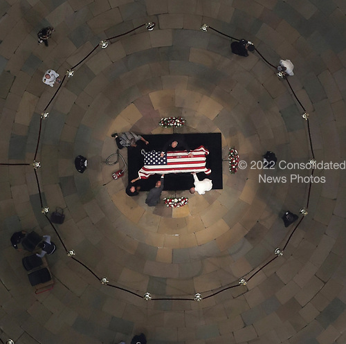 Workers clean the casket of the late U.S. Sen. John McCain, R-Ariz., as he lies in state in the U.S. Capitol Rotunda Friday, Aug. 31, 2018, in Washington. (Pool photo by Morry Gash via AP)