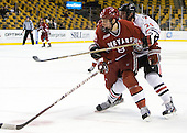 Patrick McNally (Harvard - 8), Vinny Saponari (Northeastern - 74) - The Harvard University Crimson defeated the Northeastern University Huskies 3-2 in the 2012 Beanpot consolation game on Monday, February 13, 2012, at TD Garden in Boston, Massachusetts.