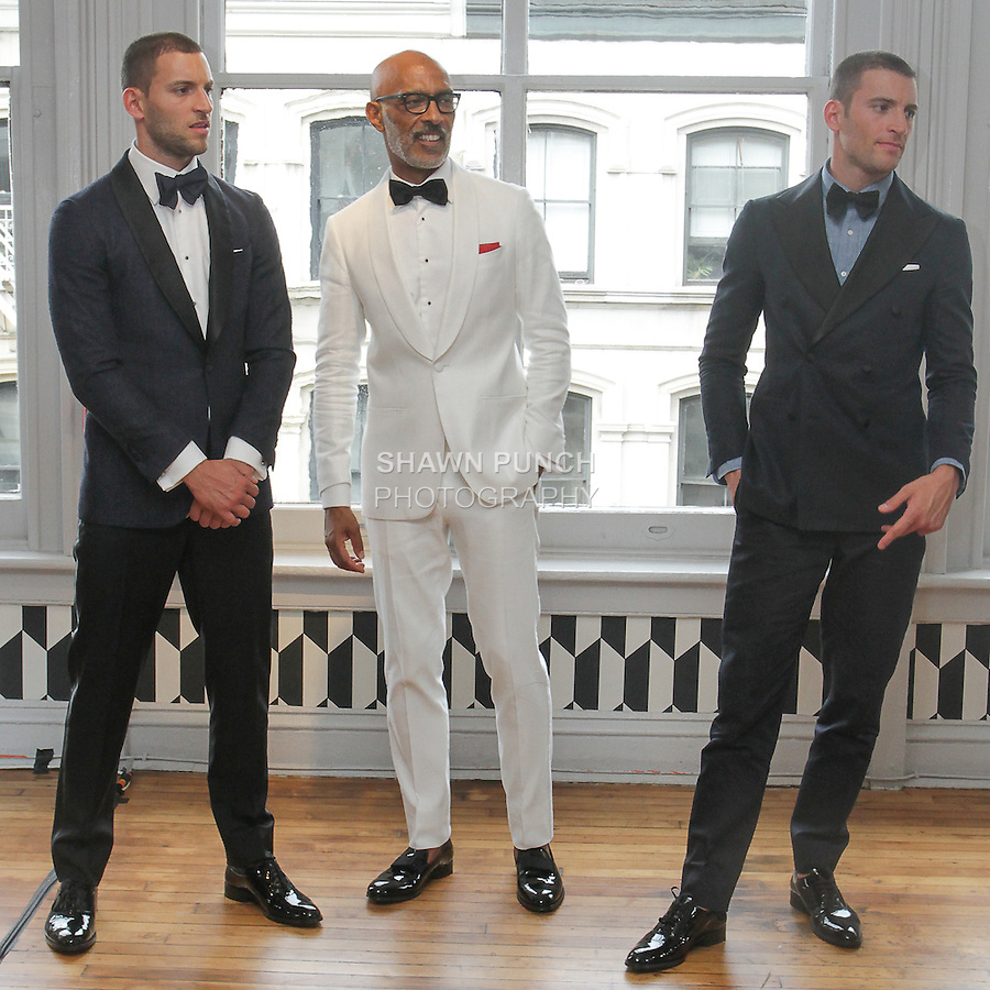 Models pose in outfits from the Suit Supply Spring Summer 2016 collection, at 453 Broome Street, during New York Fashion Week Men's Spring Summer 2016.