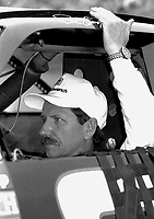 Dale Earnhardt sits in his car as he waits to qualify for the Southern 500 in Darlington, SC in September 1994.(Photo by Brian Cleary)