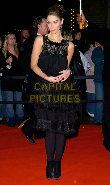 DELTA GOODREM.Arrivals - Emeralds & Ivy Ball, The Roundhouse, .London, England, December 1st 2006..full length black dress tights ankle boots bracelet ring .CAP/CAN.©Can Nguyen/Capital Pictures