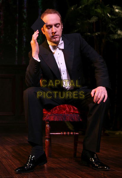 """DERREN BROWN.returns to the West End for the first time in two years with his new show """"An Evening of Wonders"""" at The Garrick Theatre, London, England, UK, .6th May 2008..full length hand bow tie black jacket tuxedo sitting hand.CAP/DS.©Dudley Smith/Capital Pictures"""