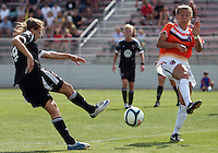 BOYDS, MARYLAND - July 22, 2012:  Ashley Herndon (19) of DC United Women blasts the ball at Kelsey Fenix (10) of the Charlotte Lady Eagles during the W League Eastern Conference Championship match at Maryland Soccerplex, in Boyds, Maryland on July 22. DC United Women won 3-0.