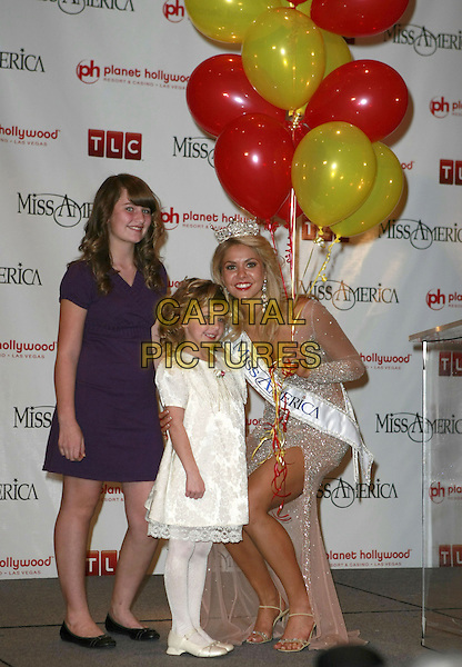2008 MISS AMERICA KIRSTEN HAGLUND - MISS MICHIGAN (pictured with Children's Miracle Network).First Official Press Conference. 2008 Miss America Live! held at Planet Hollywood Hotel Casino, Las Vegas, Nevada, USA..January 26th, 2008.full length crown sparkly dress sash split slit balloons kids bending crouching .CAP/ADM/MJT.©MJT/AdMedia/Capital Pictures. *** Local Caption *** .