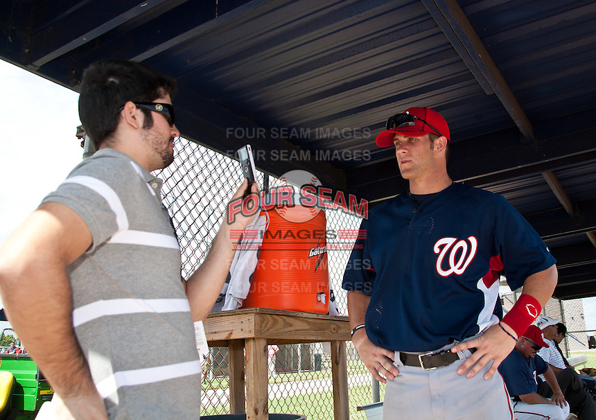 Bryce Harper of the Washington Nationals is interviewed by Alden Gonzalez of MLB.com before his first Instructional League game against the Atlanta Braves at Space Coast Stadium September 23, 2010 in Viera, Florida. Harper was the Washington Nationals 1st round pick (1st overall) of the 2010 MLB Draft. Photo By Scott Jontes/Four Seam Images