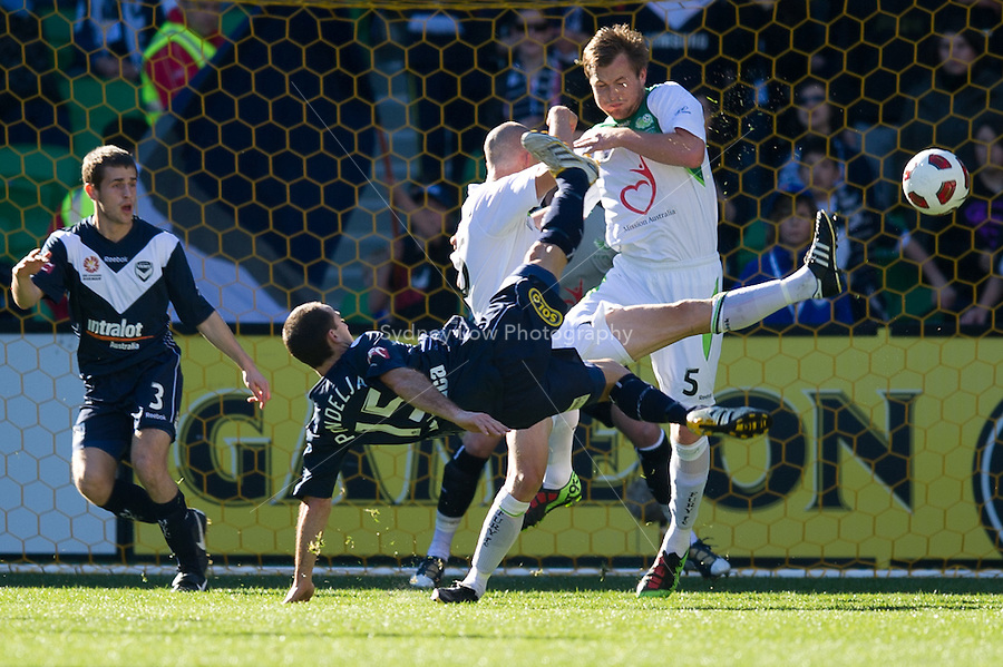 MELBOURNE, AUSTRALIA - AUGUST 22, 2010: Tom Pondeljak from the Victory kicks for goal in Round 3 of the 2010 A-League between the Melbourne Victory and North Queensland Fury at AAMI Park on August 22, 2010 in Melbourne, Australia. (Photo by Sydney Low / Asterisk Images)