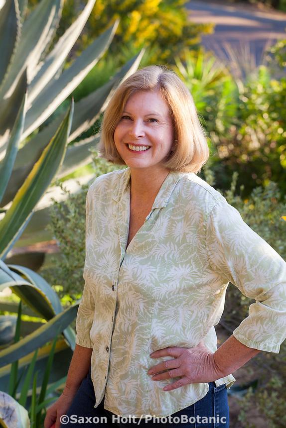 Debra Lee Baldwin author portrait in her California garden