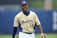 4 March 2012:  FIU outfielder Jabari Henry (14) enjoys a light moment before the game as the FIU Golden Panthers defeated the Brown University Bears, 8-3, at University Park Stadium in Miami, Florida.