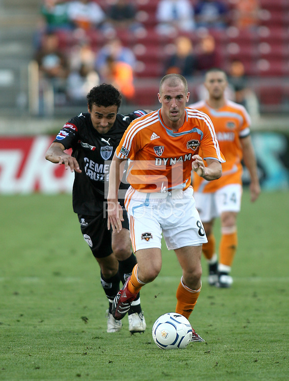 Houston Dynamo forward Paul Dalglish (8) dribbles away from FC Pachuca defender Leobardo Lopez (2).   Houston Dynamo beat FC Pachuca 2-0 at Robertson Stadium in Houston, TX on March 15, 2007 in the first of a two game series in the CONCACAF Champions' Cup semi-finals.