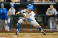 UCLA third baseman Kevin Kramer (7) squares to bunt during Game 1 of the 2013 Men's College World Series Finals against the Mississippi State Bulldogs on June 24, 2013 at TD Ameritrade Park in Omaha, Nebraska. The Bruins defeated the Bulldogs 3-1, taking a 1-0 lead in the best of 3 series. (Andrew Woolley/Four Seam Images)