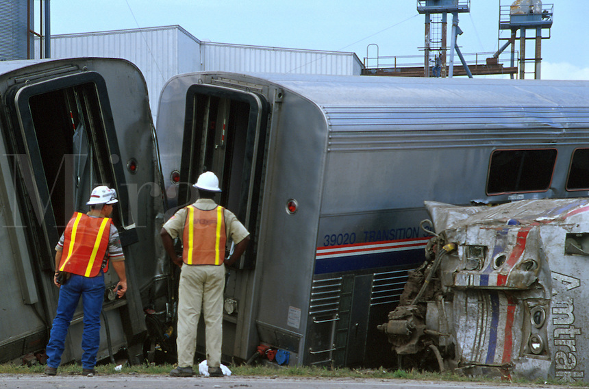 Railroad employees surveying damage to Amtrak train after derailment at Eagle Lake, Texas. Railroad employees. Eagle Lake Texas.