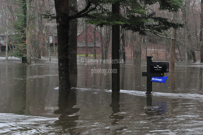 Falls River Flooding Across Dennison Road in Essex CT on 30 March 2010. Water halfway to Hartford Courant Paper box and Mailbox on post. Small stream over bound it's banks here.