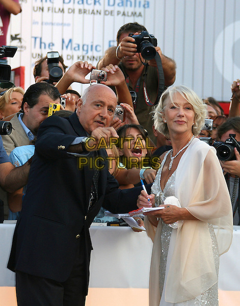 "DAME HELEN MIRREN.""The Queen"" Premiere during The 63rd International Venice Film Festival held at Palazzo del Cinema, Lido, Venice, Italy, 02 September 2006..half length signing autographs fans .Ref: ADM/ZL.www.capitalpictures.com.sales@capitalpictures.com.©Zach Lipp/AdMedia/Capital Pictures."
