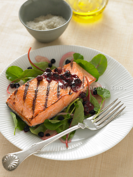 Grilled fillet of silver (Coho) salmon, on a bed of fresh greens