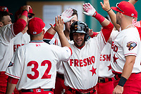Fresno Grizzlies outfielder Yadiel Hernandez (13) is congratulated by teammates after hitting a home run during a game against the Reno Aces at Chukchansi Park on April 8, 2019 in Fresno, California. Fresno defeated Reno 7-6. (Zachary Lucy/Four Seam Images)
