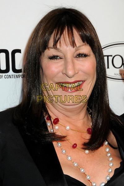 ANJELICA HUSTON .TOD's Beverly Hills Boutique Launch Celebration held at TOD's Boutique, Beverly Hills, California, USA, .15th April 2010..portrait headshot red lipstick make-up necklace smiling fringe pearls beads pearl black .CAP/ADM/BP.©Byron Purvis/AdMedia/Capital Pictures.