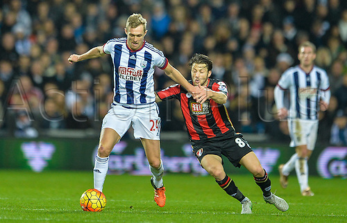 19.12.2015. The Hawthorns, West Bromwich, England. Barclays Premier League. West Bromwich Albion versus AFC Bournemouth. Harry Arter of Bournemouth tries to hold back Darren Fletcher of West Bromwich Albion.