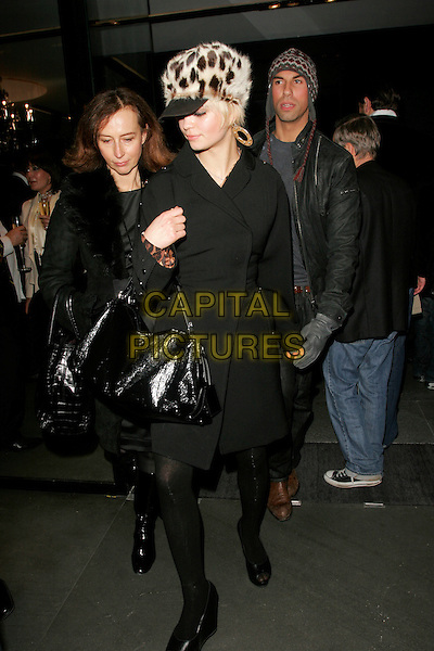 PIXIE GELDOF.Dolce & Gabbana Store, Old Bond Street, London, England..December 13th, 2007.full length black bag purse patent leopard print fur hat hoop earrings gold coat jacket .CAP/AH.©Adam Houghton/Capital Pictures.