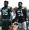 Josh Martin #95, left, and Brandon Copeland #51 of the New York Jets take off their helmet to cool down during a hot day of Training Camp at the Atlantic Health Jets Training Center in Florham Park, NJ on Saturday, Aug. 18, 2018.