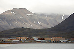 Pyramiden (Danish, Norwegian and Swedish meaning &quot;the pyramid&quot;, Russian: ????????, piramida) is an abandoned Russian settlement and coal mining community on the archipelago of Svalbard, Norway. It was founded by Sweden in 1910 and sold to the Soviet Union in 1927. It lies at the foot of the Billefjorden on the island of Spitsbergen and is named for the pyramid-shaped mountain adjacent to the town.<br /> <br /> The settlement once had a population of over 1,000 inhabitants,[1] but was abandoned on 10 January 1998 by its owner, the state-owned Russian company Arktikugol Trust. It is now a ghost town. Within the buildings, things remain largely as they were when the settlement was abandoned in a hurry.<br /> <br /> There are no restrictions on visiting Pyramiden, but visitors may not enter any buildings without permission, even if the doors are open, due to the health and safety hazards involved. While most buildings are now locked, breaking into the buildings, vandalism and theft have become a serious threat to Pyramiden.