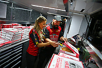 Apr 22, 2017; Baytown, TX, USA; NHRA top fuel driver Leah Pritchett grabs a pepperoncini pepper from a box of pizza during qualifying for the Springnationals at Royal Purple Raceway. Mandatory Credit: Mark J. Rebilas-USA TODAY Sports