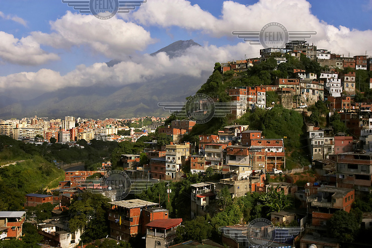 Slum housing in a hillside barrio (right) and high-rise downtown buildings (background left).