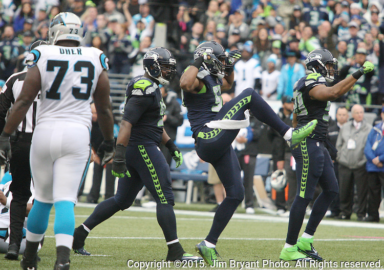 Seattle Seahawks  linebacker K.J. Wrights celibates after bringing down Carolina Panthers  running back Jonathan Stewart (28) for a loss at CenturyLink Field in Seattle on October 18, 2015. The Panthers came from behind with 32 seconds remaining in the 4th Quarter to beat the Seahawks 27-23.  ©2015 Jim Bryant Photography. All Rights Reserved.