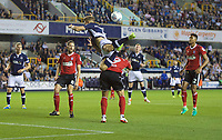Shaun Hutchinson of Millwall gets high on Martyn Waghorn of Ipswich Town during the Sky Bet Championship match between Millwall and Ipswich Town at The Den, London, England on 15 August 2017. Photo by Alan  Stanford / PRiME Media Images.