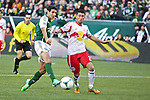March 3, 2013; Portland, OR, USA; Portland Timbers midfielder Diego Valeri (8) scores the Timbers' first goal against New York Red Bulls to tie the game 1-1 in the first half at Jeld-Wen Field.  Mandatory Credit: Jaime Valdez-USA TODAY Sports
