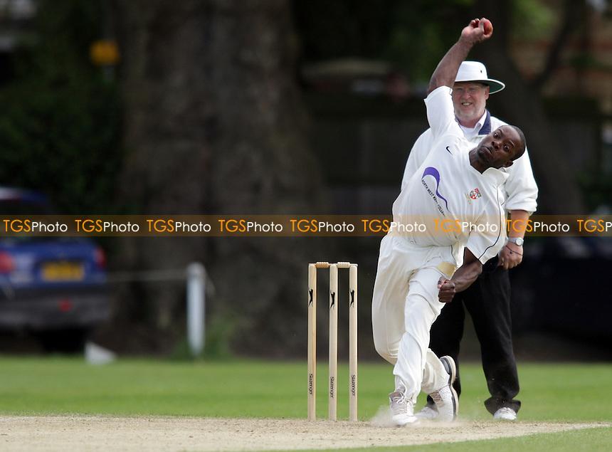 W. Morgan of Bromley bowls - Beckenham CC vs Bromley CC - Kent Cricket League at Foxgrove Road - 02/06/12 - MANDATORY CREDIT: Helen Watson/TGSPHOTO - Self billing applies where appropriate - 0845 094 6026 - contact@tgsphoto.co.uk - NO UNPAID USE.